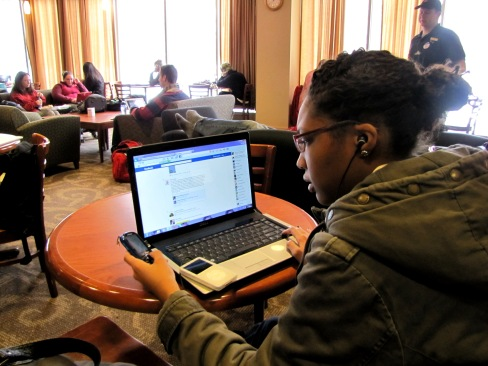 "OU Sophomore Rachel Moulden reads a text while using her laptop and iPod. ""I use technology a lot during school,"" Moulden said. ""But sometimes you just need to take a break, because it can be a hindrance."""