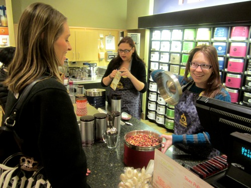 Teavana associate Lauren Delmonico, right, shows a customer the Wild Orange Blossom loose tea. PHOTO/STEPHANIE SOKOL