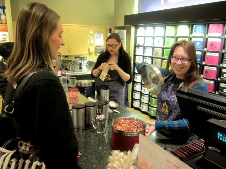 Teavana associate Lauren Delmonico, right, shows a customer the Wild Orange Blossom loose tea. PHOTO/STEPHANIE SOKOL