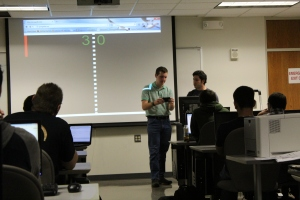 "Photo/Stephanie Sokol Dominic Dabish demonstrates ""Pong With Me"" during one of Sebnem Onsay's programming courses."